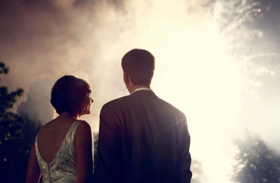 Bride and Groom looking at night fireworks wedding day