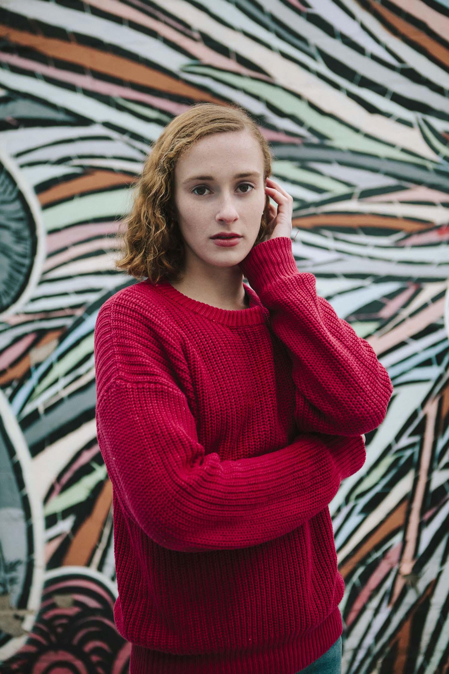 Woman in red sweater posing graffiti mural, Minneapolis Minnesota Commercial Portrait Photographers headshots