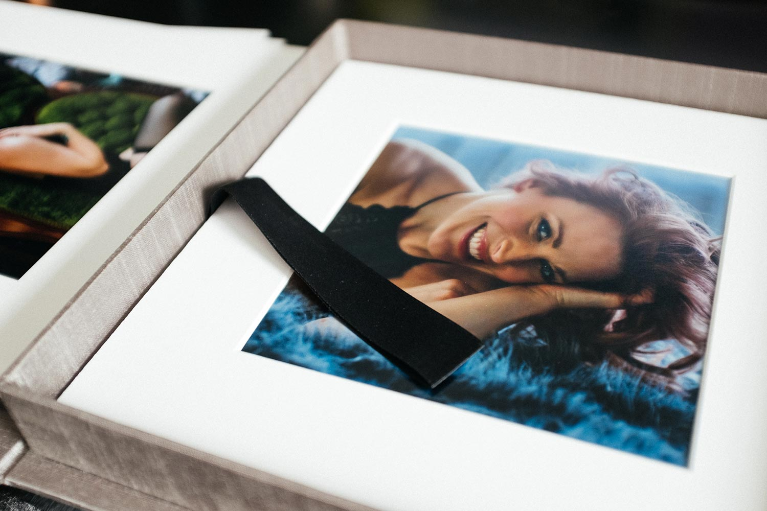 Opened view of 10x10 fine art print box, 6x6 prints matted in a white frame. Saint Paul Boudoir Photographer