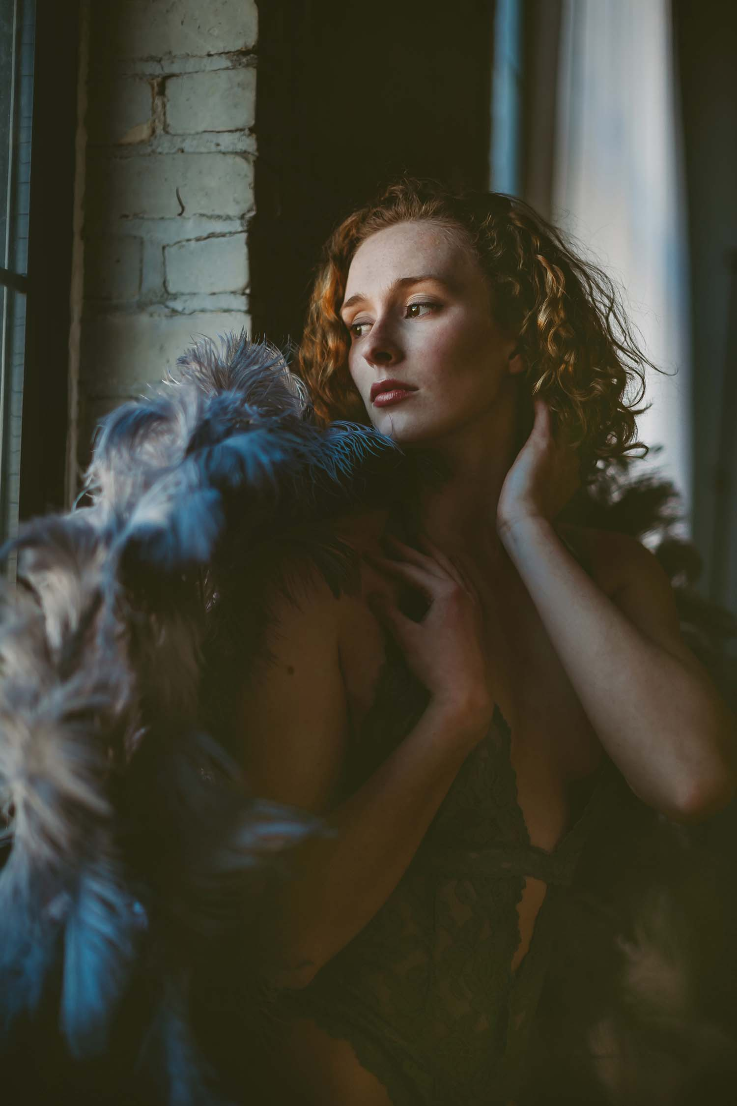 Woman dark moody portrait window natural light wings Minneapolis MN Minnesota Boudoir Photography Intimate Lifestyle, angel, silver, gray, grey, Twin Cities, Saint Paul, Minnesota, Chicago, Midwest, Wisconsin, Iowa, South Dakota, Boudoire