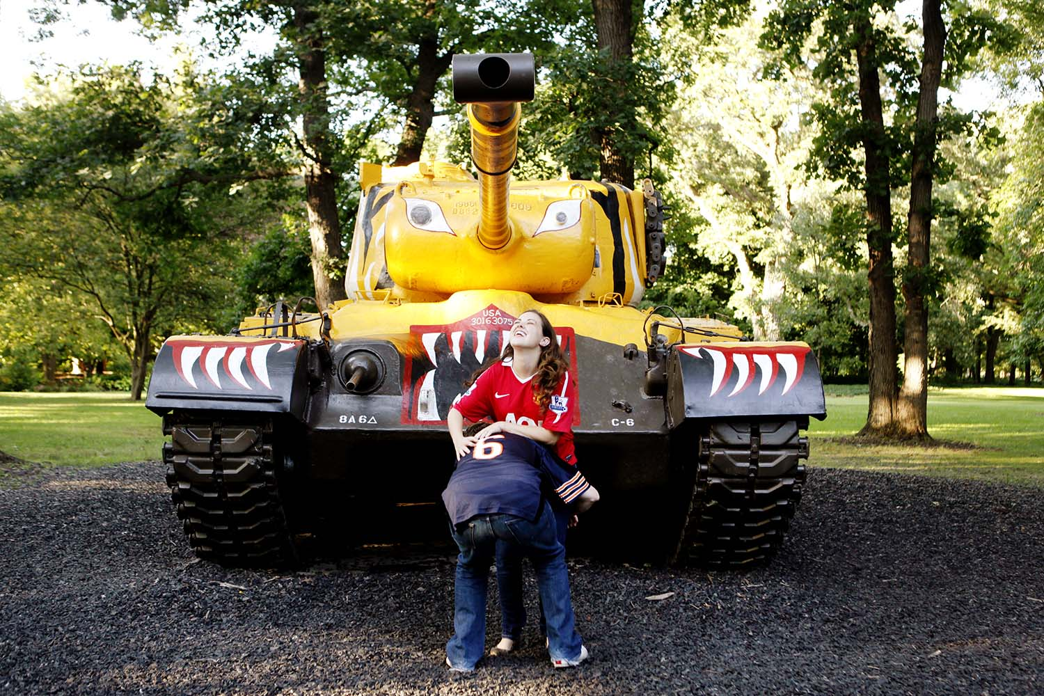 Cantigny First Military tanks museum engagement photography, Illinois, engaged, summer, day, sunny, Katie & Mike, spring, fun, funny, silly, cute, photos, yellow, painted