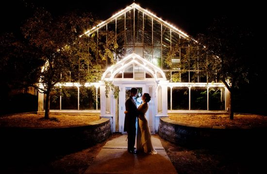 Bride and Groom wedding portrait night time in front of glass green house wedding Chicago, Illinois destination wedding photographer Glass Green house night wedding portrait