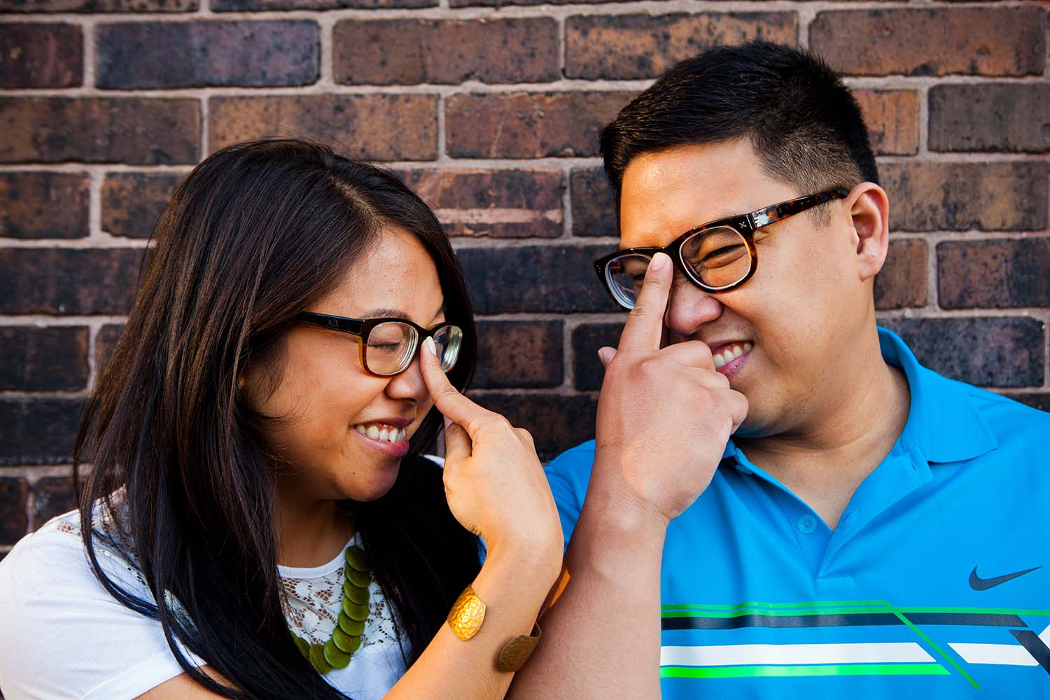 nerdy couple, glasses, brick, wall, Chicago, engagement photography, Saint Paul Wedding Photographer, fun, silly, cute