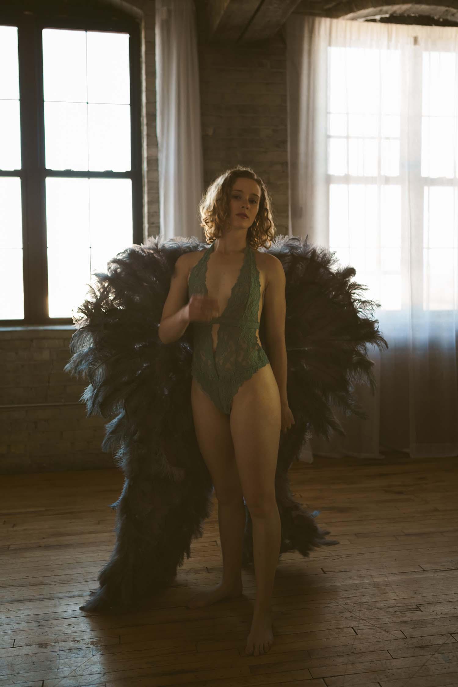 Dar moody  boudoir photo shoot angel wings prop. MN Boudoir photographer