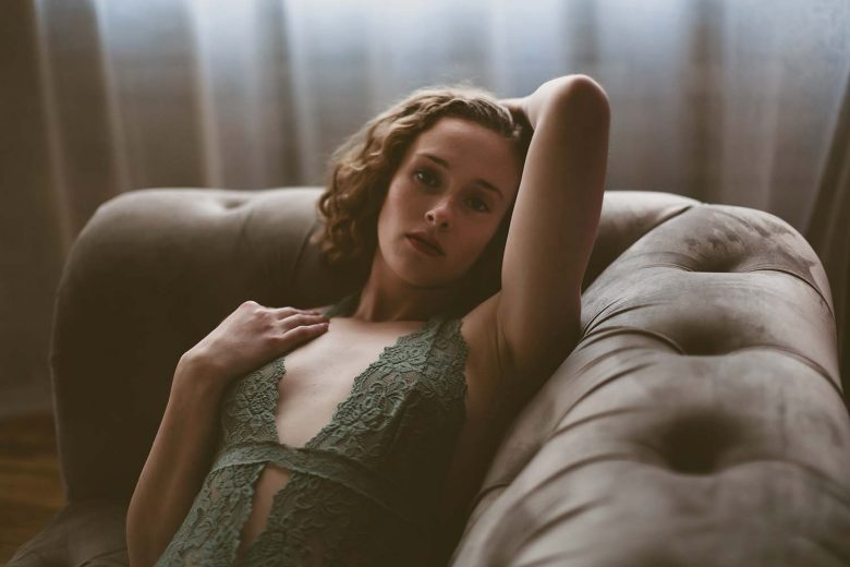 Jessi, warm, boudoir, portrait, sensual, sexy, intimate, lifestyle, living, room, couch, loft, studio, green seafoam, lace, bodysuit