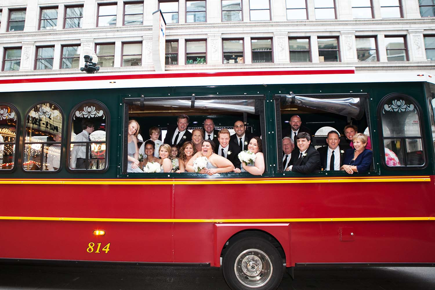 Happy and fun bridal party catches bus. Saint Paul Wedding Photographer
