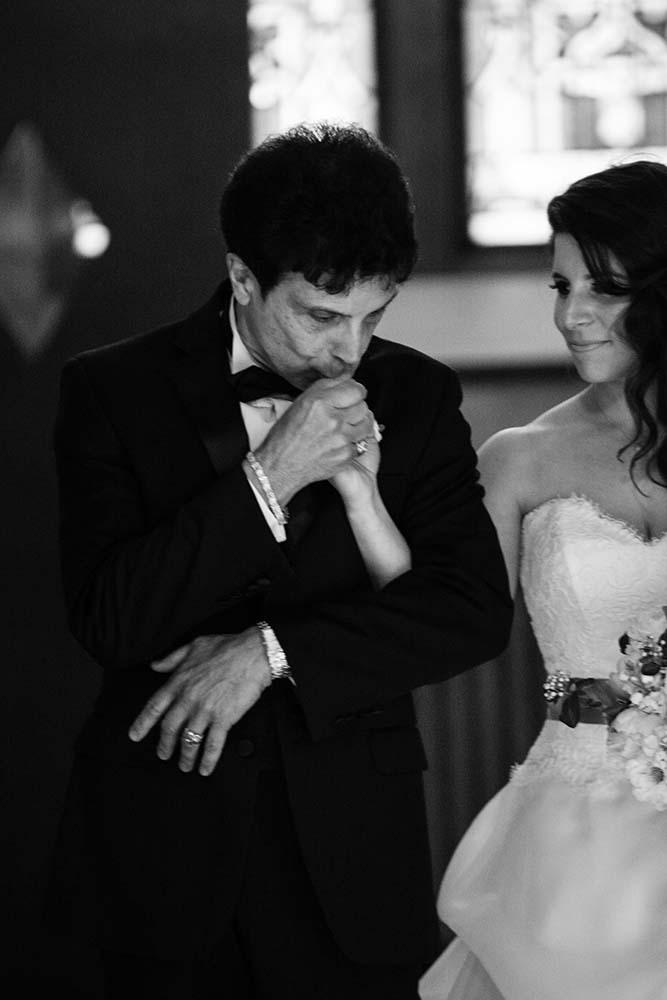 Classic Elegant black and white portrait of bride walking down the aisle. Minneapolis Wedding Photographer
