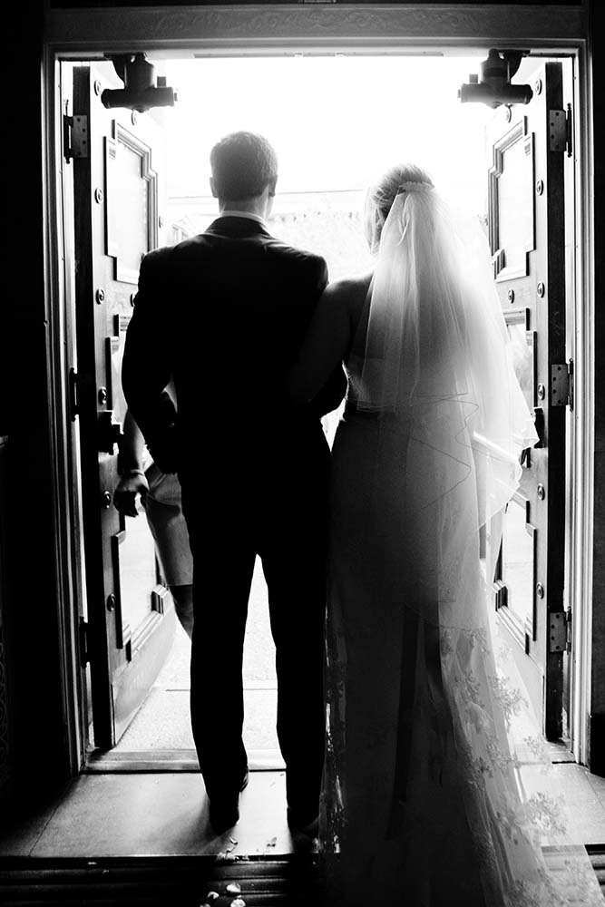 Documentary wedding photography, wedding photojournalism, bride groom exiting church