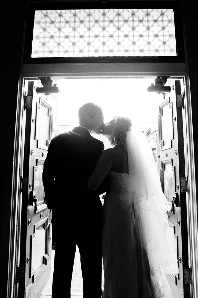 Black and white image documentary, bride and groom exiting church after wedding ceremony, Park Ridge, Illinois, Chicago Wedding Photographers
