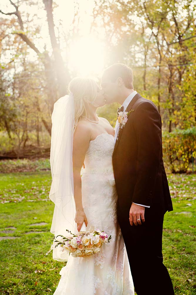 Kristina & John Married, sun flare wedding portrait, vintage wedding photography, bride and groom kissing, autumn, fall wedding portrait, outdoors, nature, Midwest wedding photographers