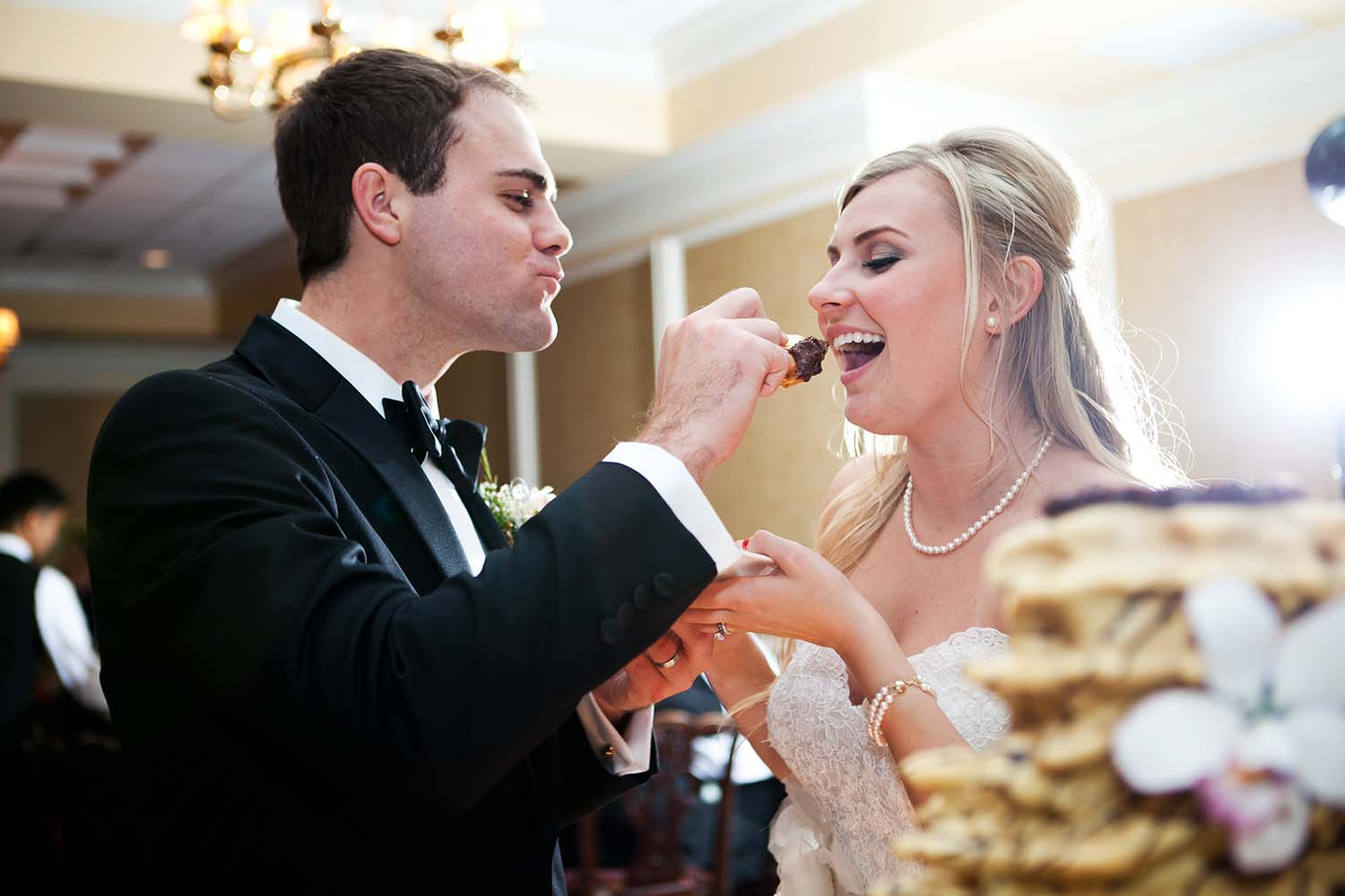 Kristina & John Married, cutting wedding cake, feeding each other a piece of cake, bride and groom cake