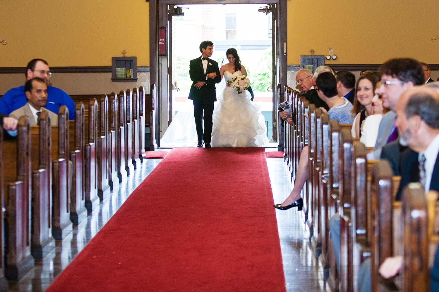 Bride and father of the bride walk down the aisle. Minneapolis Wedding photography