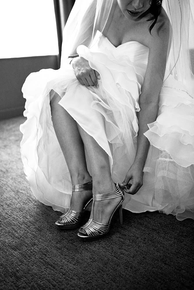 High fashion wedding photography, bride getting ready, bride putting on wedding shoes