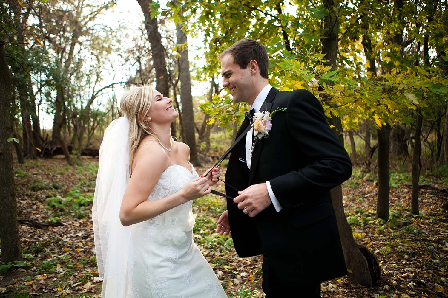 Kristina & John Married, bride pulling on grooms suspenders, fun wedding photography, cute wedding photo, fall, autumn, October Wedding