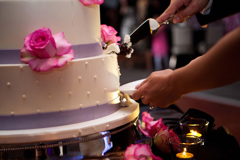 Cutting the wedding cake at a Wedding Loews Hotel Rosemont, Illinois