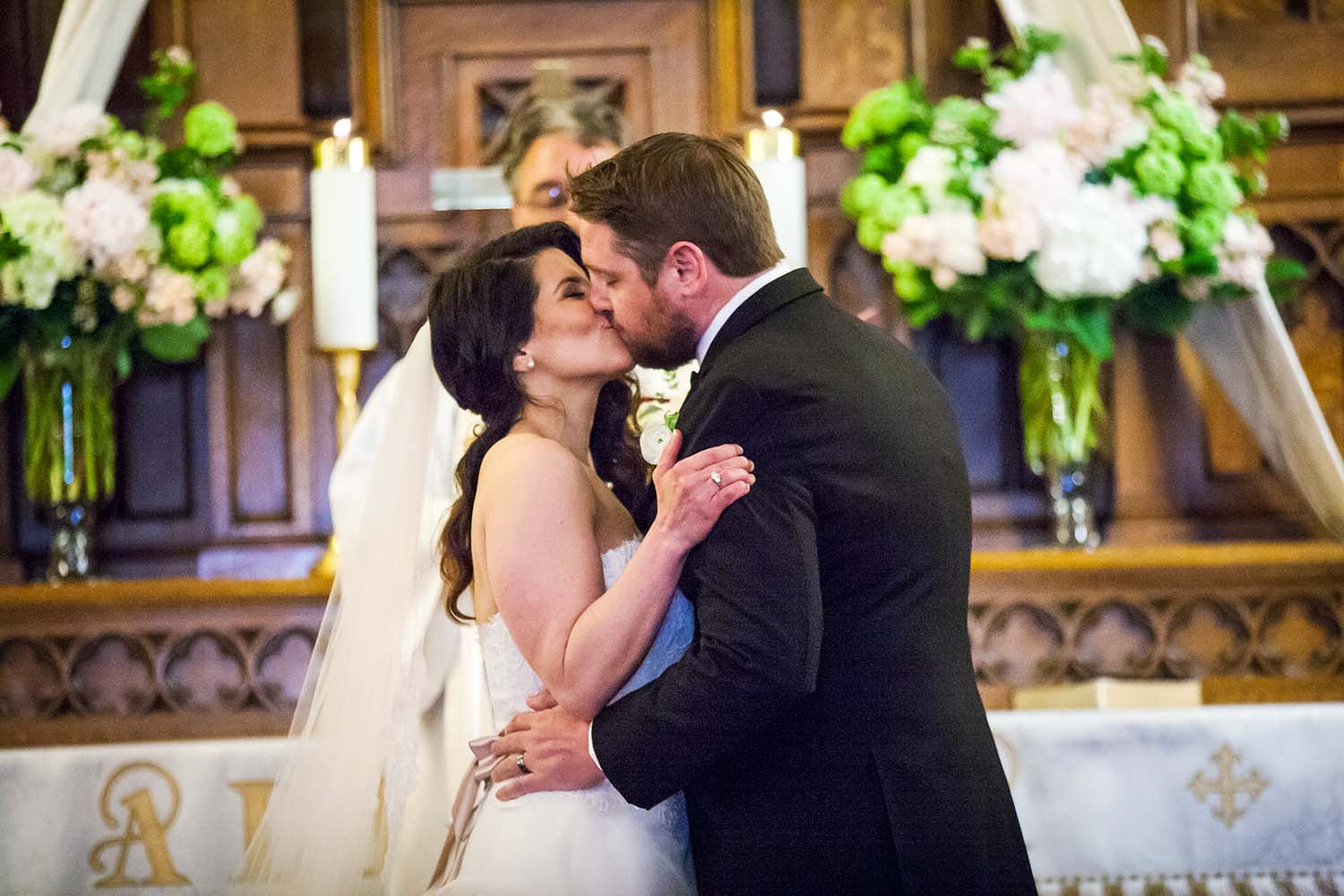 Newlyweds First Kiss as husband and wife. Twin Cities Wedding Photographer