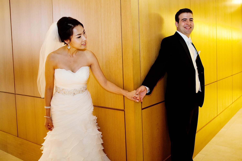 Groom and bride holding hands. Minneapolis Wedding Photographer, Cathy & Alan's Wedding Loews Hotel