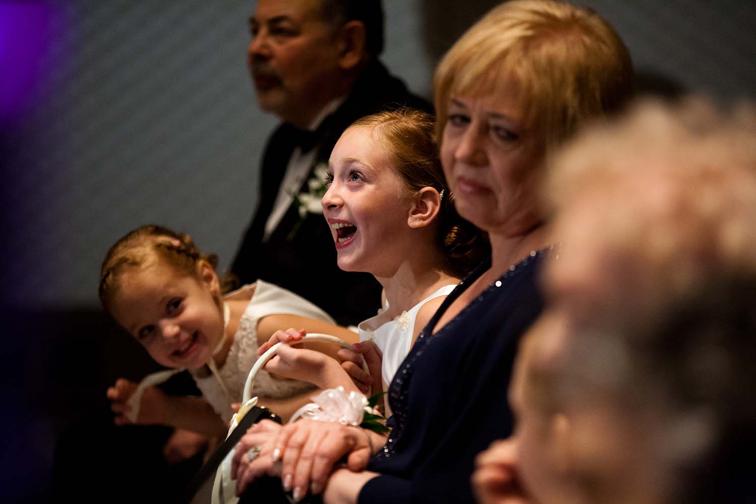 Flower girl laughing during Jewish wedding ceremony