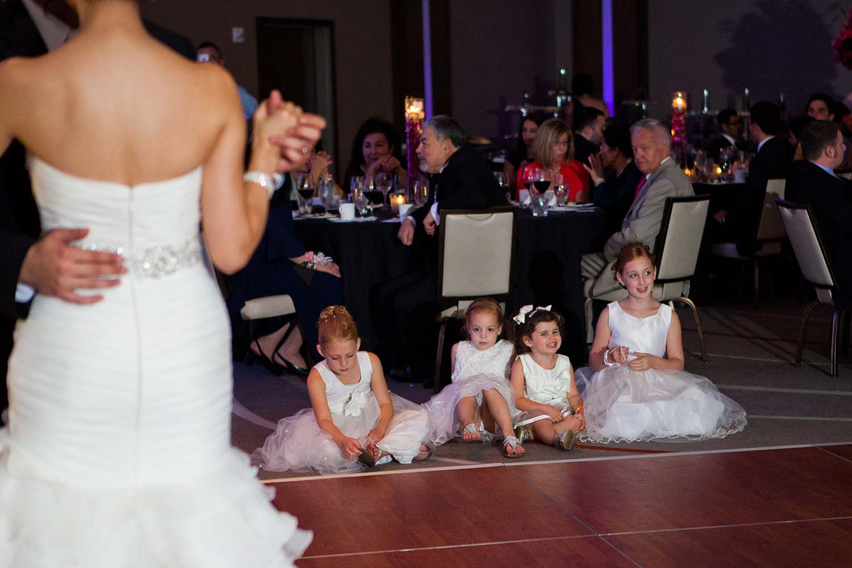 wedding loews hotel, flower girls watching bride and groom first dance