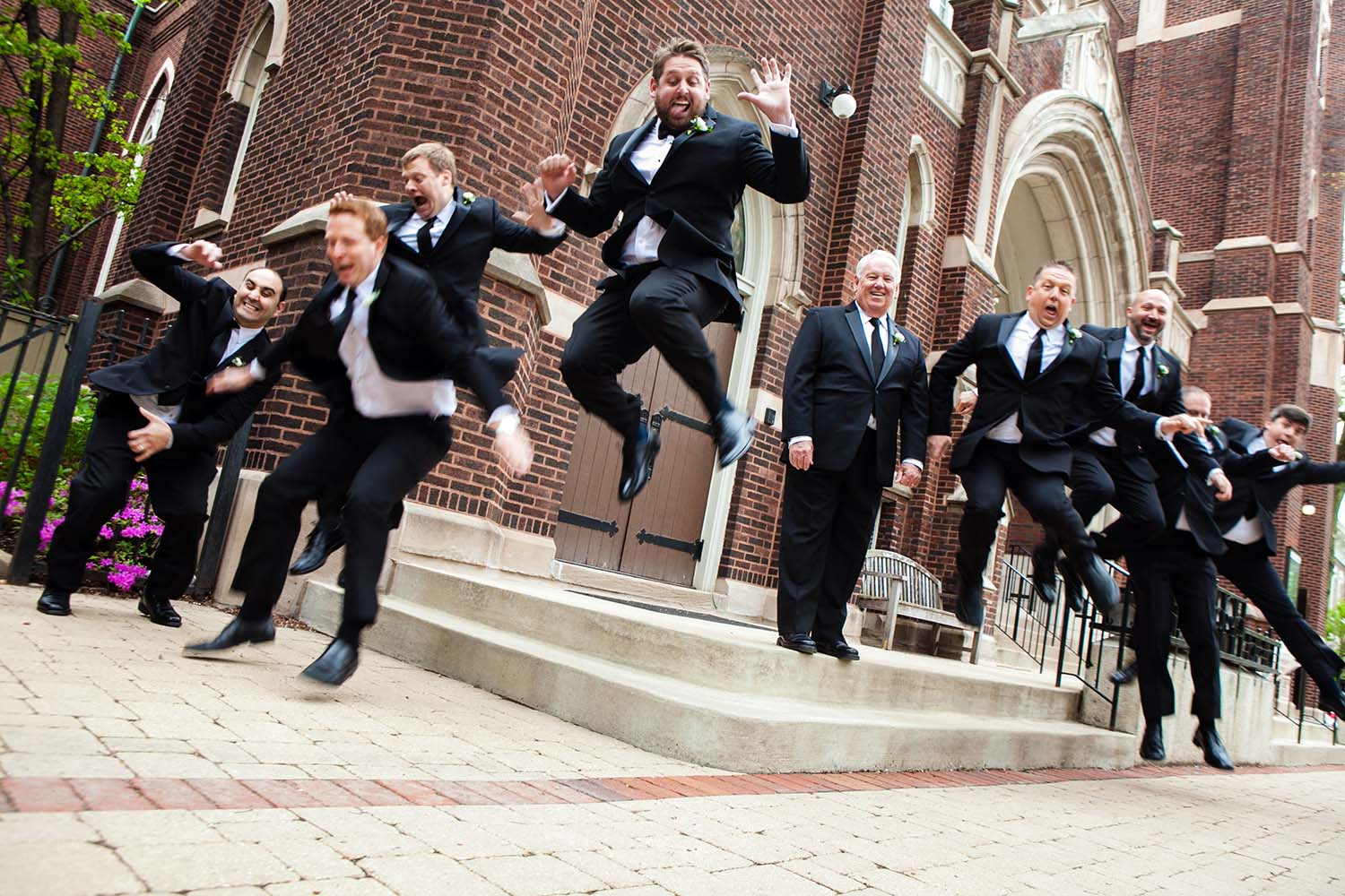 groom and groomsmen portrait perfectly-coordinated jump. Twin Cities Wedding Photography
