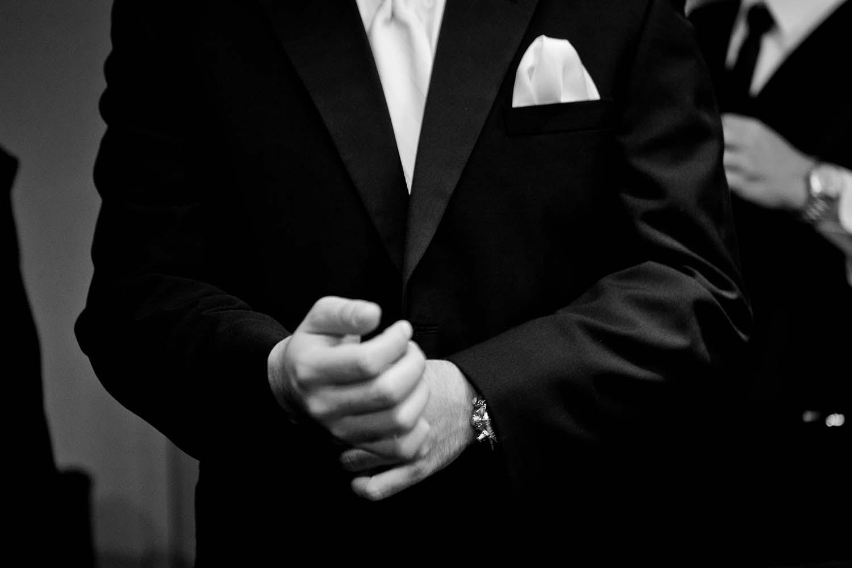 Groom gets ready for wedding ceremony at Loews Hotel. St Paul Wedding Documentary Photographers