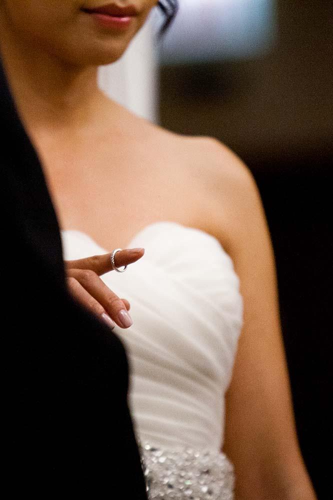 Detail of bride holding wedding ring during Jewish wedding ceremony, documentary wedding photography, photojournalism, candid