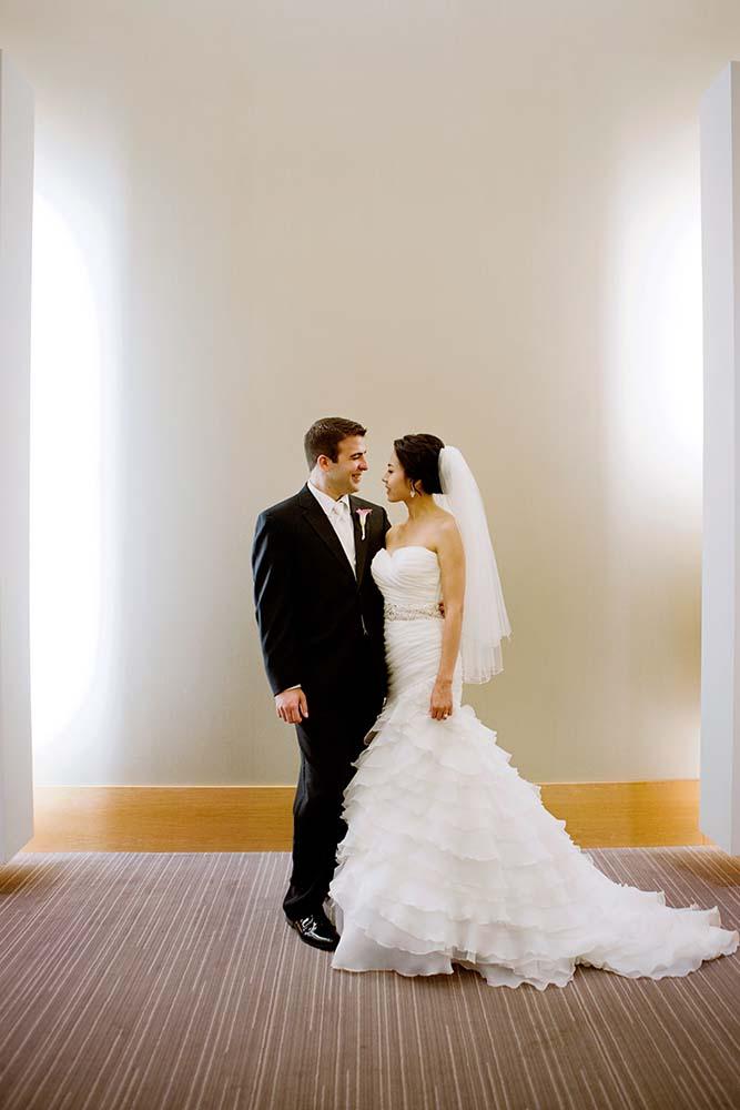Groom and bride portrait at Loews Hotel. Minneapolis Wedding Photographer