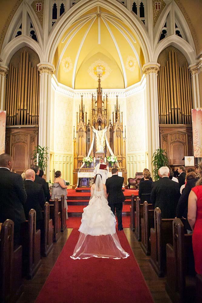 Pastor Robert Donovan officiates wedding ceremony,   Twin Cities Wedding Photographers