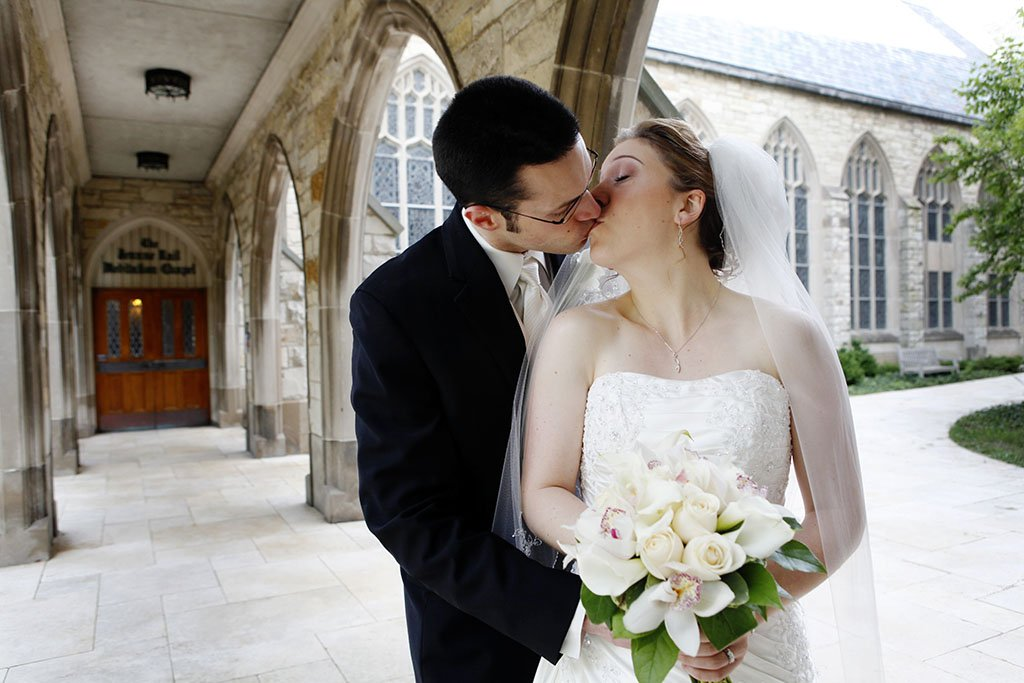 Alice Millar Chapel Archway Wedding Portrait, kissing bride and groom