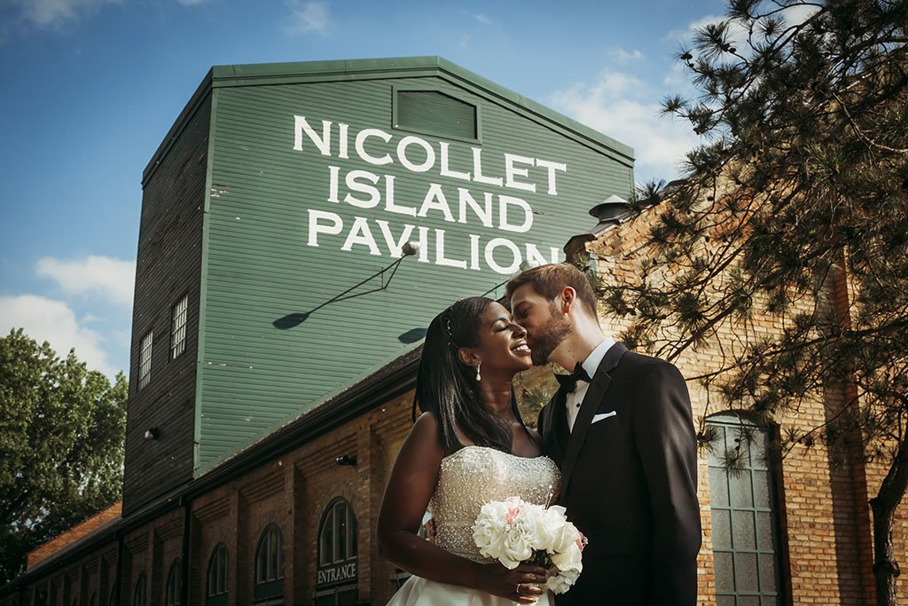 Bride and Groom in front of Nicollet Pavilion, summer wedding Twin Cities, Minneapolis Wedding Photographer