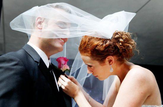 Bride Pinning Groom Boutinerre Candid Fun