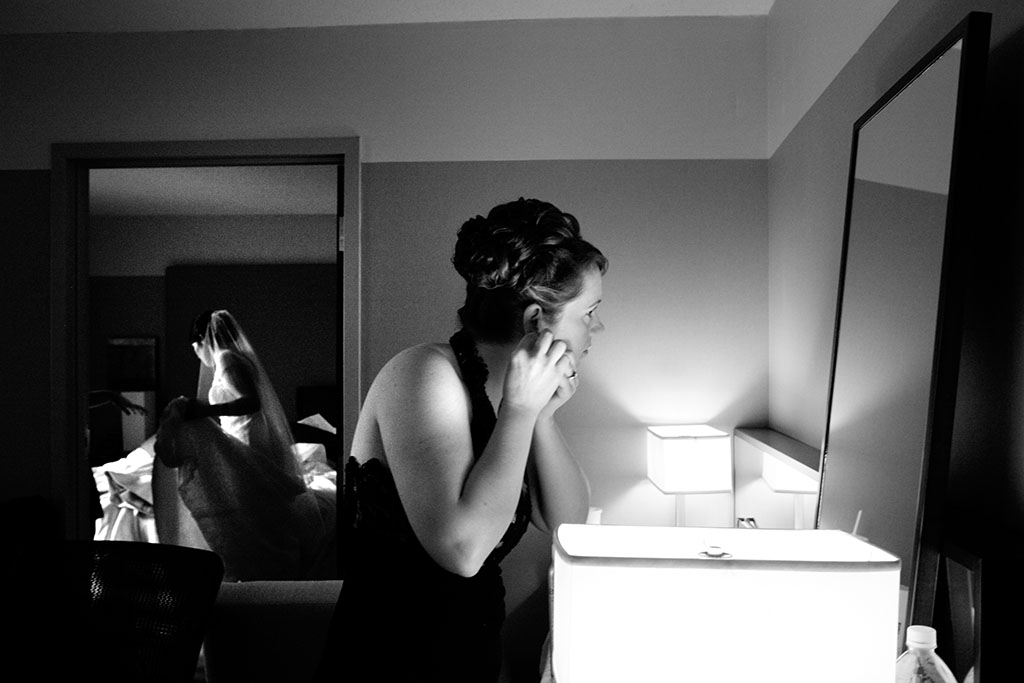 Bridesmaid getting ready, candid documentary wedding photography