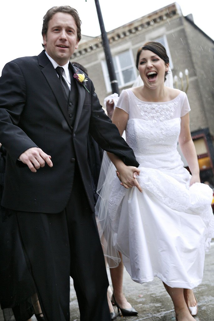 Action photo of bride and groom running from the rain, Wicker Park Chicago