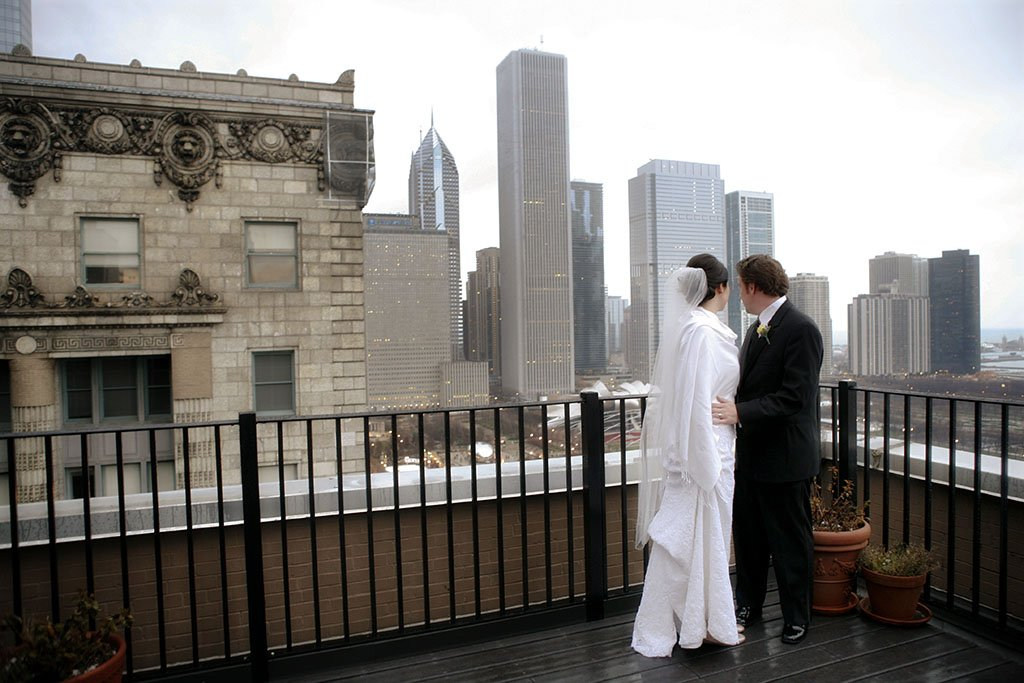 John & Kathleen, Balcony of the Cliff Dwellers Club bride and groom wedding photojournalism with view of Chicago skyline