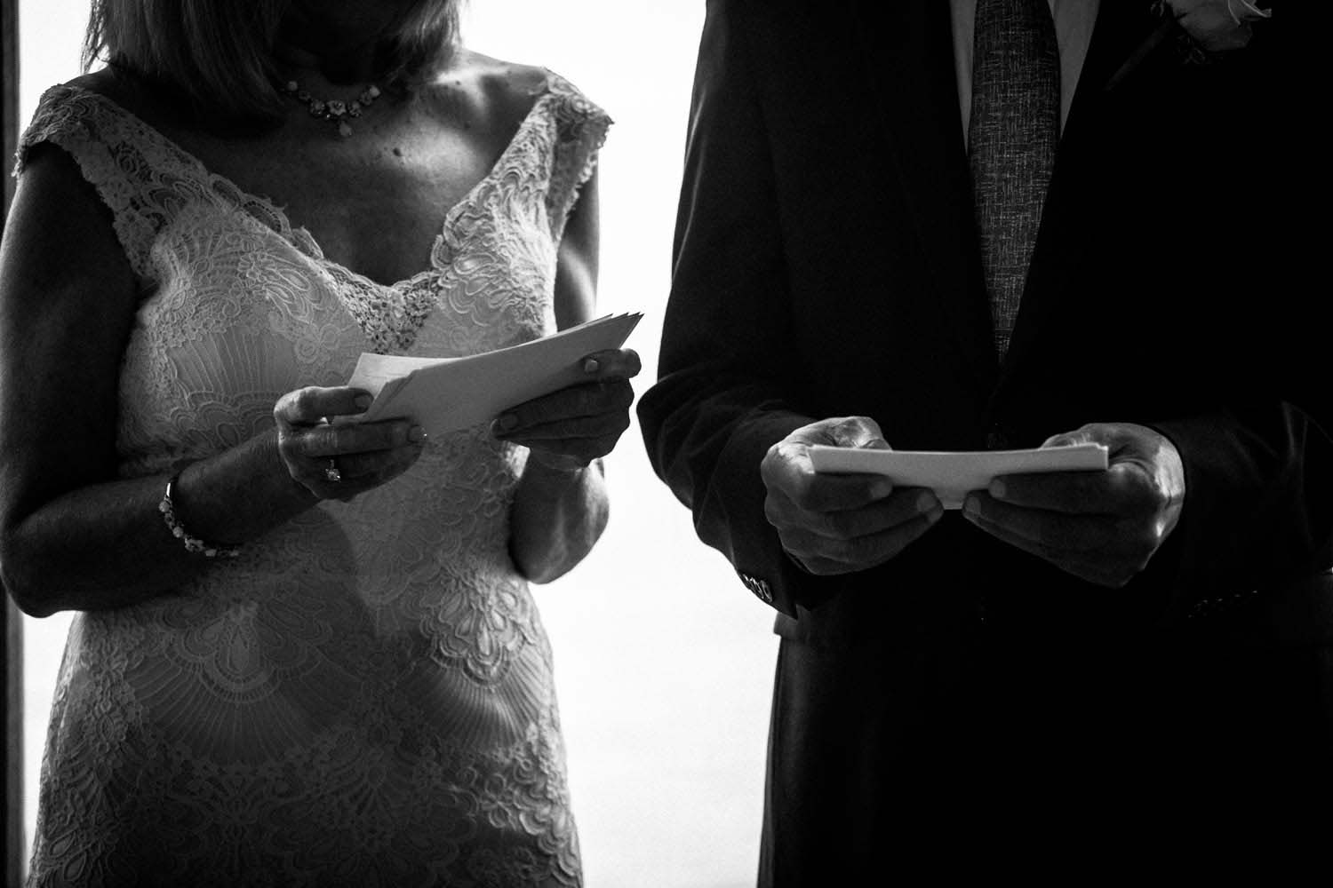 Couple reading vows photojournalism Two Harbors Wedding Photographers