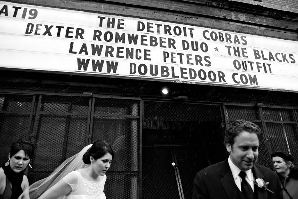 John & Kathleen, documentary candid wedding portrait photography in front of the Double Door concert venue Chicago