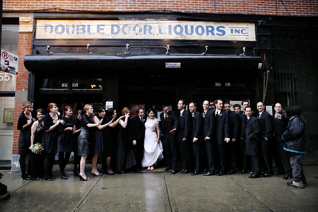 John & Kathleen, photojournalism bridal party wedding portrait photography in front of the Double Door concert venue Chicago