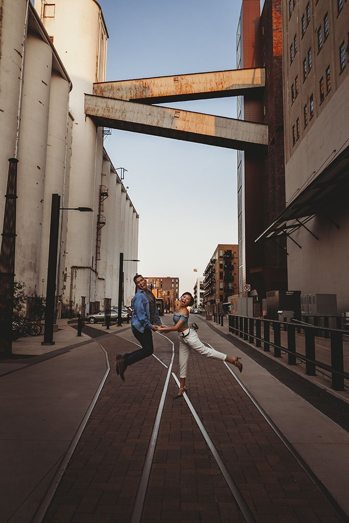 Grain Silo St Anthony Minneapolis Engagement Photographers, jump, jumping, photo, photography, fun, silly, MPLS, main, theater, train tracks, goofy