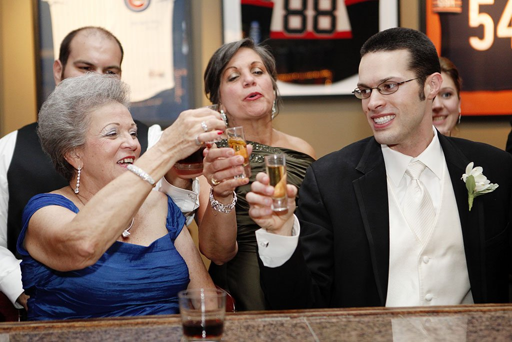 Groom Grandmother Toasts Wedding Reception Bar