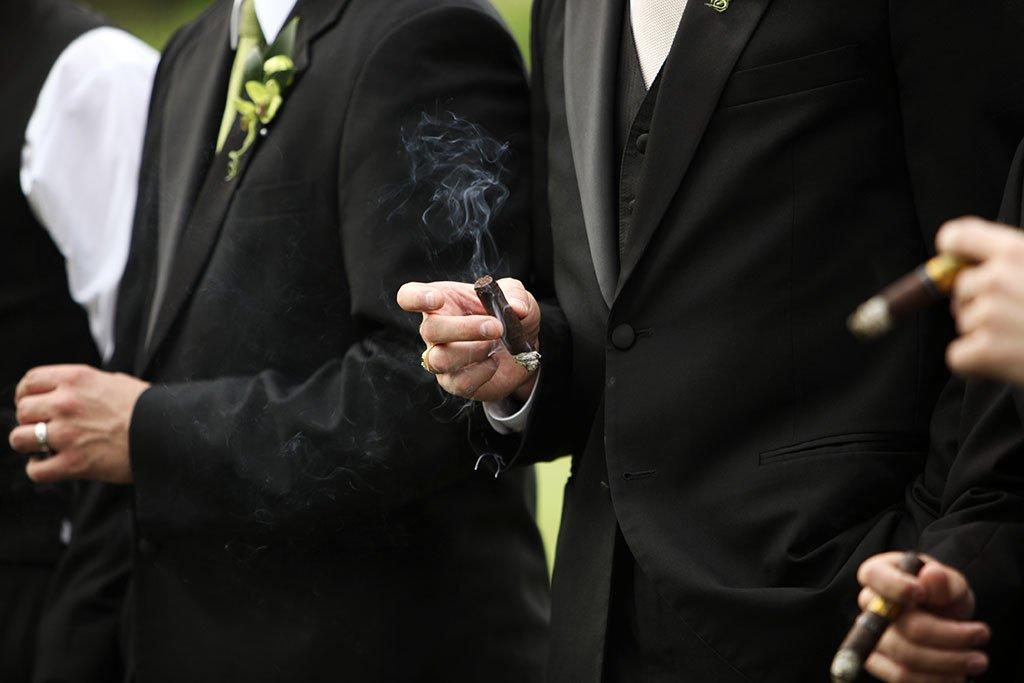 Groom smoking cigar, wedding photography minnesota