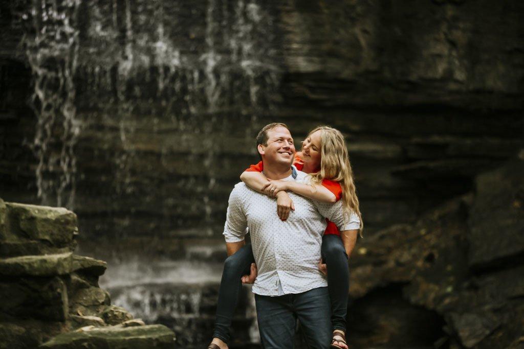 Piggy back ride, Twin Cities Wedding Photographer, Summer engagement portraits, Minneapolis water fall