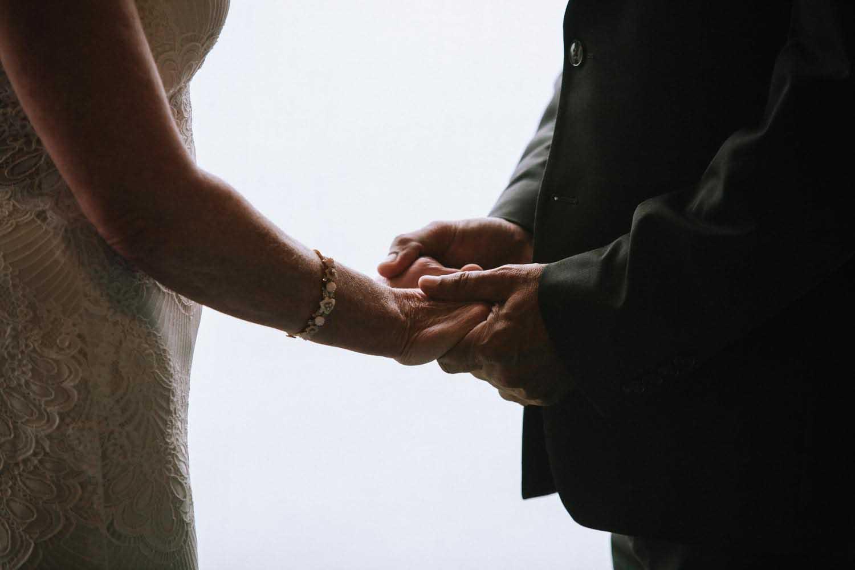 Natural Light Wedding Ceremony hands detail. Minnesota Wedding Photographer