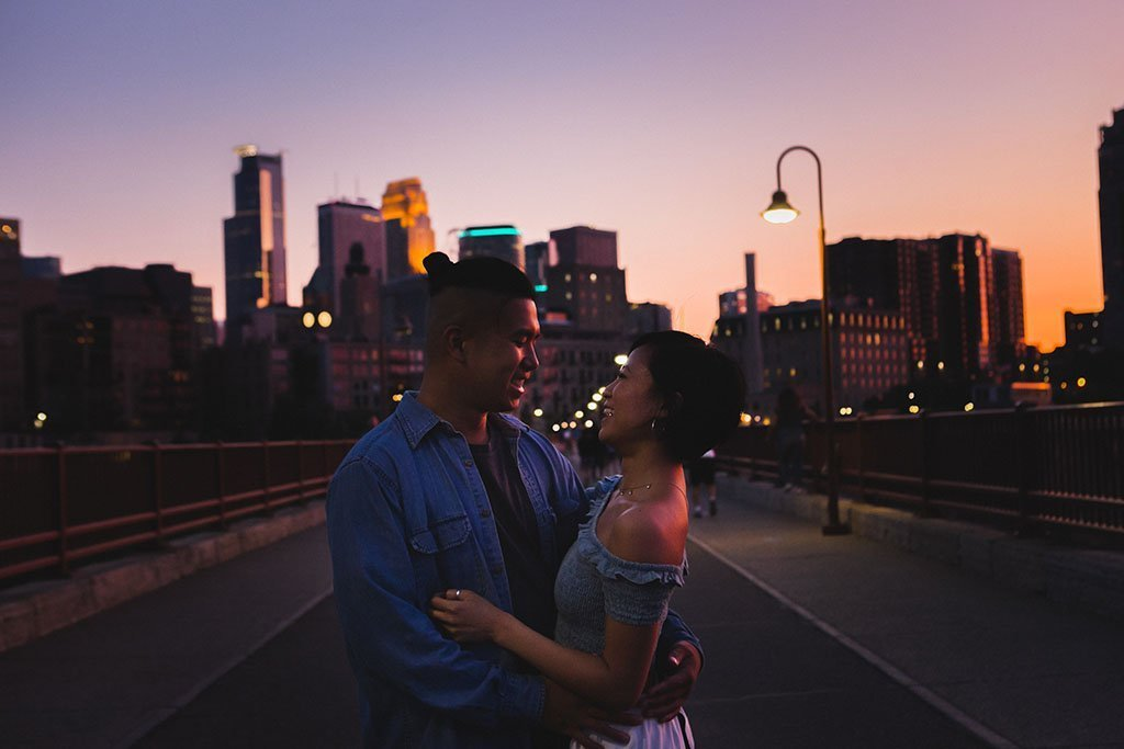 Stone Arch Bridge Sunset Skyline Minneapolis Engagement Photographers, photojournalism, docuentary, candid, street, photography, Twin Cities, downtown, skyline, dusk, twilight